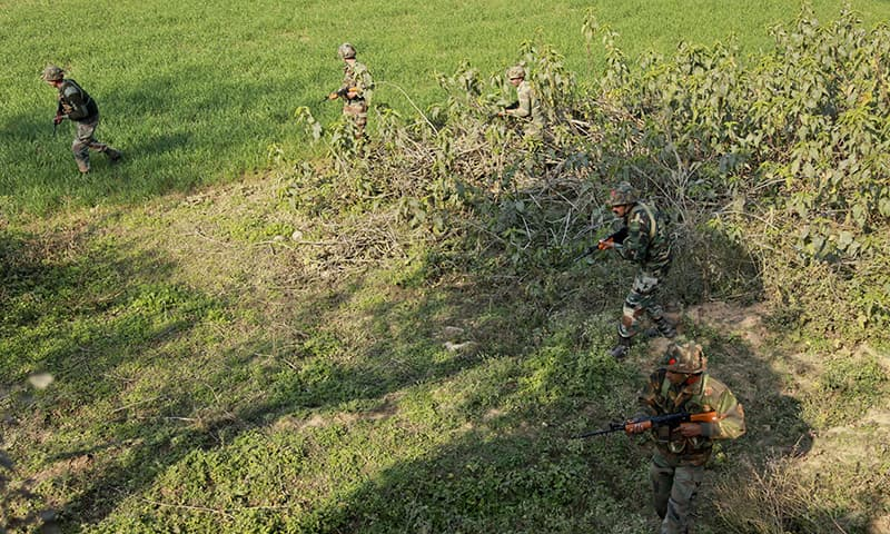 Indian army soldiers conduct a search operation in a forest area outside the Pathankot air force base. ─ AP
