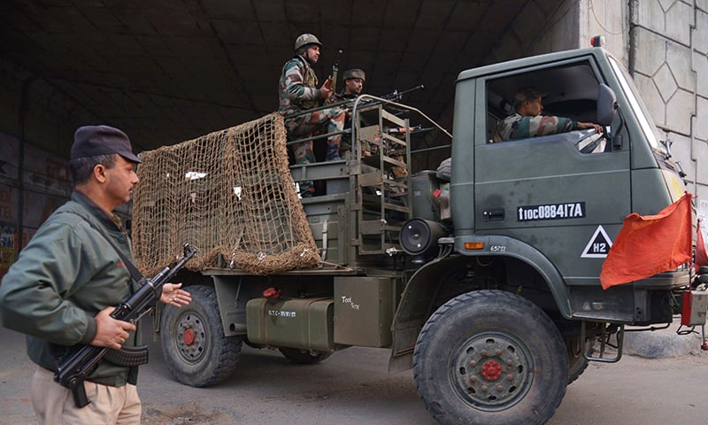 An Indian Army truck transports troops to the air force base in Pathankot- AFP