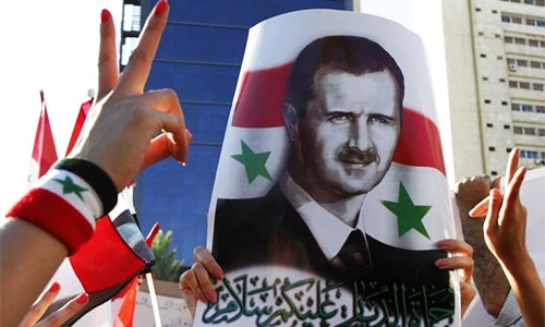 In policy shift, US sees Assad staying in Syria until March 2017