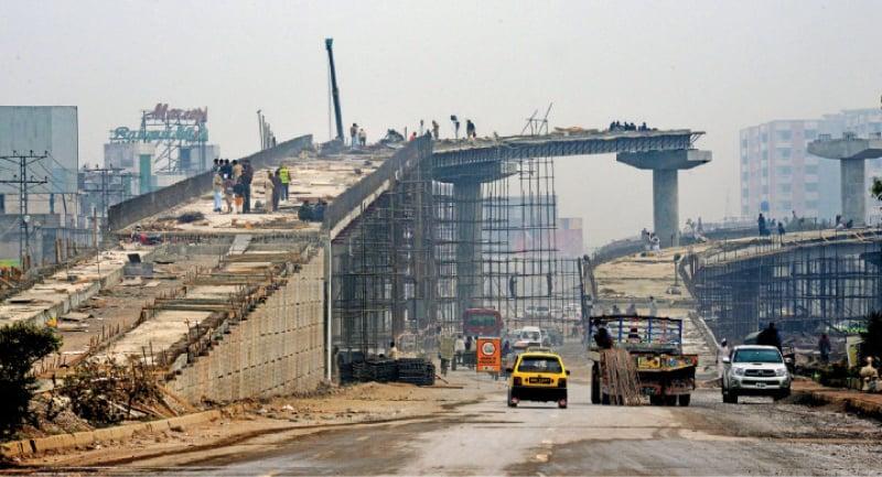 Work underway on Bab-i-Peshawar Flyover. — File photo