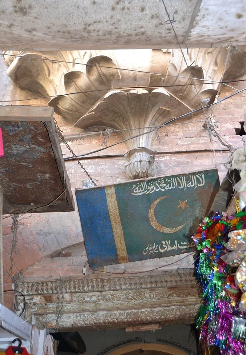 Jamaat-i-Islami's signboard conceals the plaque of Gurudwara.