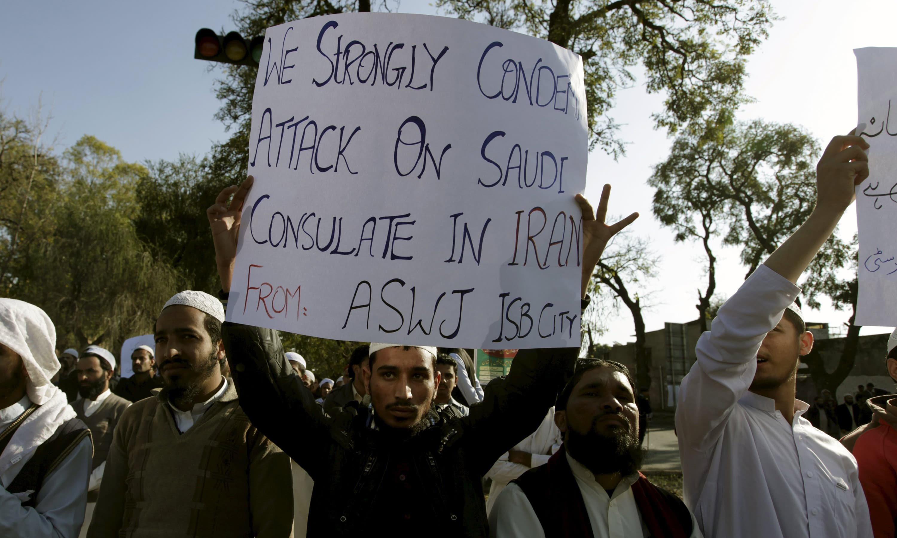 An ASWJ supporter  holds a placard to condemn the attack on Saudi consulate in Iran. —Reuters