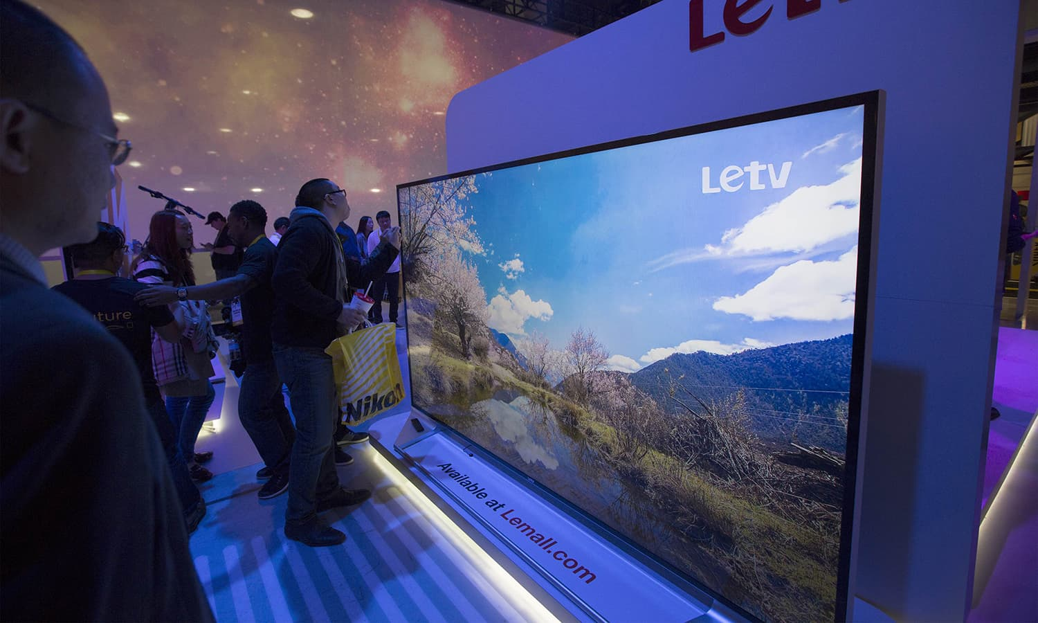 People look at the Letv 120-inch UHD 4K panel at the CES 2016 Consumer Electronics Show. — AFP