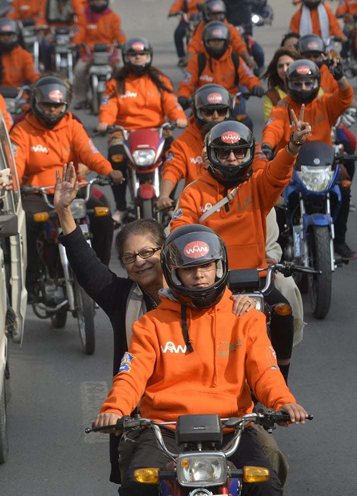 Asma Jahangir taking part in the 2017 Women on Wheels rally in Lahore.─ AFP/File