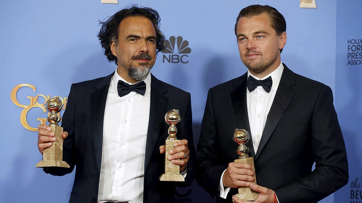 Director Alejandro Gonzalez Inarritu and actor Leonardo DiCaprio pose with their Golden Globes they won for 'The Revenant'.─Reuters/FIle