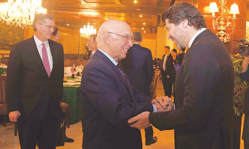 THE Prime Minister's Adviser on Foreign Affairs Sartaj Aziz shakes hands with Afghan Deputy Foreign Minister Hekmat Khalil Karzai prior to a meeting of delegates from Pakistan, Afghanistan, China and the United States. US Special Representative for Afghanistan and Pakistan Richard Olson is seen at left.—White Star
