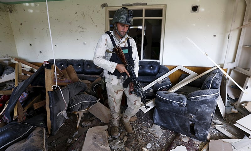 A member of the Afghan security force inspects a damaged building after a blast near the Pakistani consulate in Jalalabad. -Reuters
