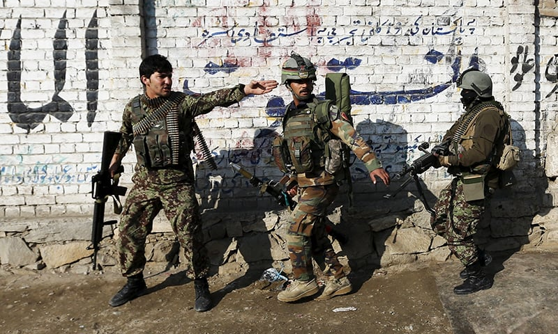 Afghan National Army (ANA) soldiers arrive after a blast near the Pakistani consulate in Jalalabad. -Reuters