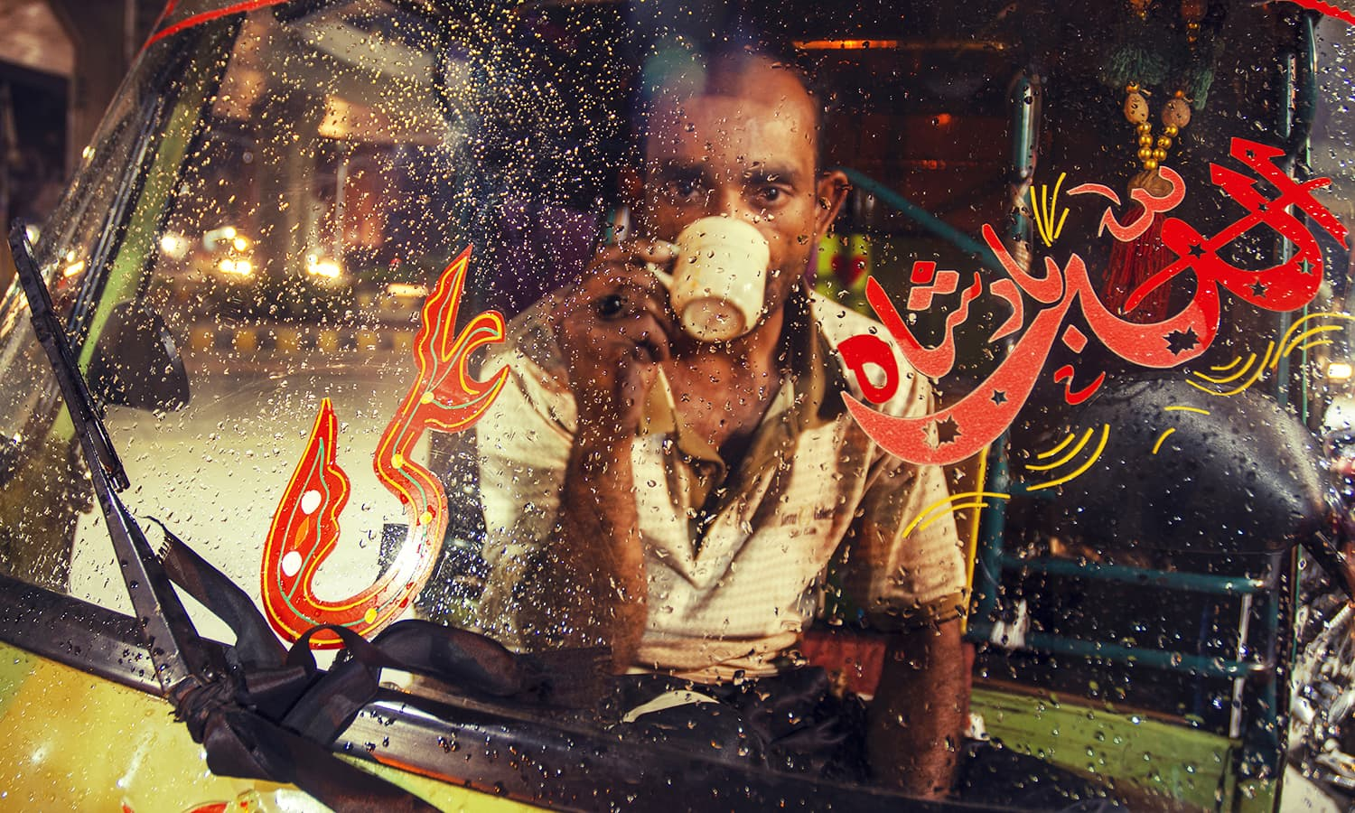 A rickshaw driver in Lahore enjoying a brief moment of solitude. In the 1990s, tongas and buggies were replaced by noisy vehicles. —Photo by Khalil Shah/The copyrights of the image are the sole property of the photographer and cannot be re-sold or transferred in any way.