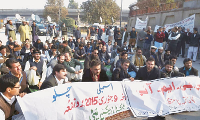 Doctors stage a sit-in in front of the Khyber Pakhtunkhwa Assembly building in Peshawar