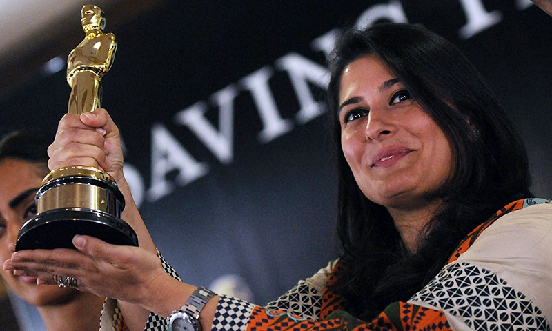 In this file photograph taken on March 10, 2012, Oscar-winning Pakistani director Sharmeen Obaid-Chinoy poses for a photograph with the award during a press conference in Karachi.—AFP