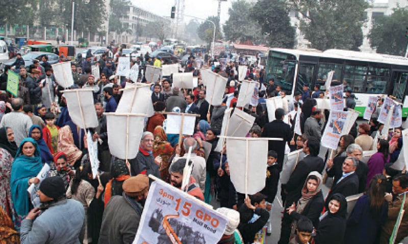 LAHORE: Civil society, political activists and affectees hold a demonstration at GPO Chowk against the Orange Line project.—Online