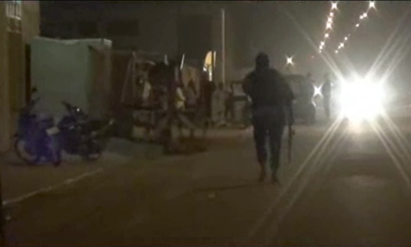 In this image taken from video from AP Television, an armed policeman walks away near the Splendid Hotel.—AP