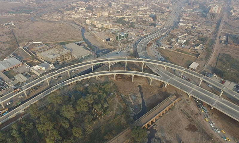 Later, the chief minister drove on the flyover. —Photo courtesy PTI