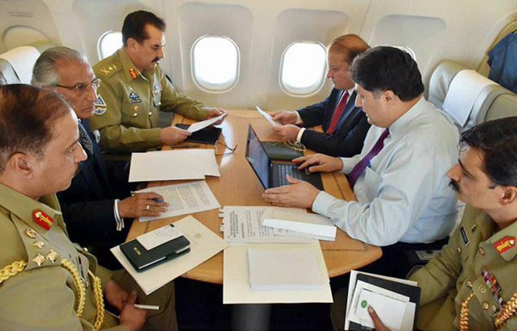 Prime Minister Nawaz Sharif, Army Chief General Raheel Sharif and other members of Pakistani delegation busy in  consultations during the flight to Riyadh on Monday.—INP