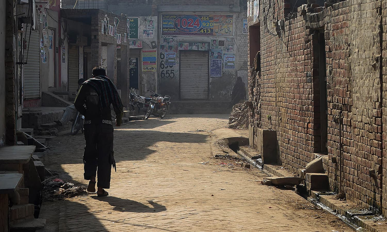 A Pakistani victim of child abuse walks along a street in Hussain Khan Wala village in Punjab province. — AFP