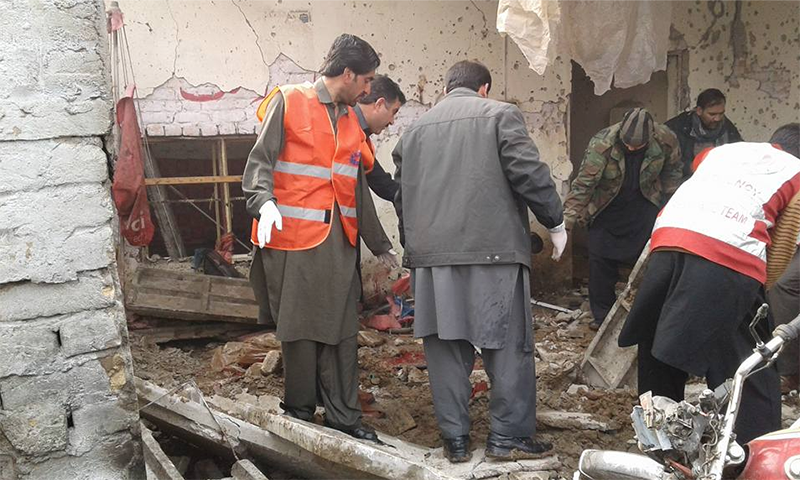 Rescue officials inspect the site of the blast.—Photo by author