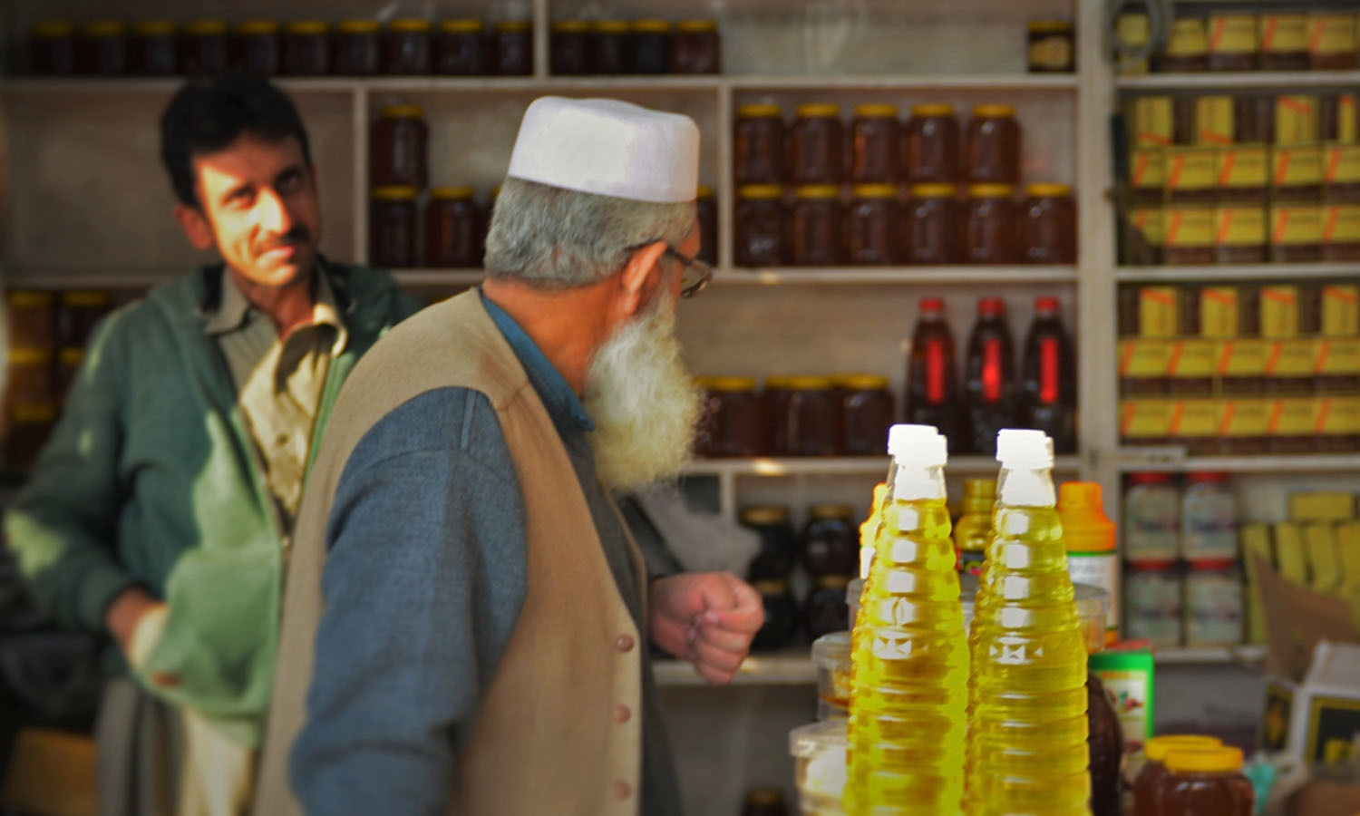 Customers at a shop in Peshawar's honey market. — Photo by author