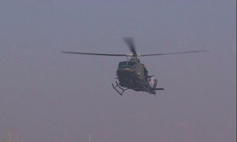 A helicopter of the Pakistan Army is monitoring the situation from the air. — DawnNews