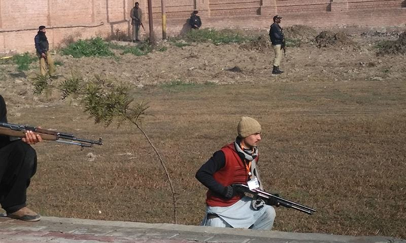 This photograph taken from a mobile phone shows security personnel taking position outside the Bacha Khan university - AFP
