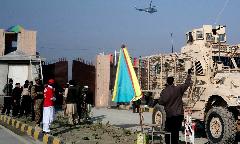 A Pakistani army vehicle (R) enters the Bacha Khan university following an attack by gunmen in Charsadda. — AFP