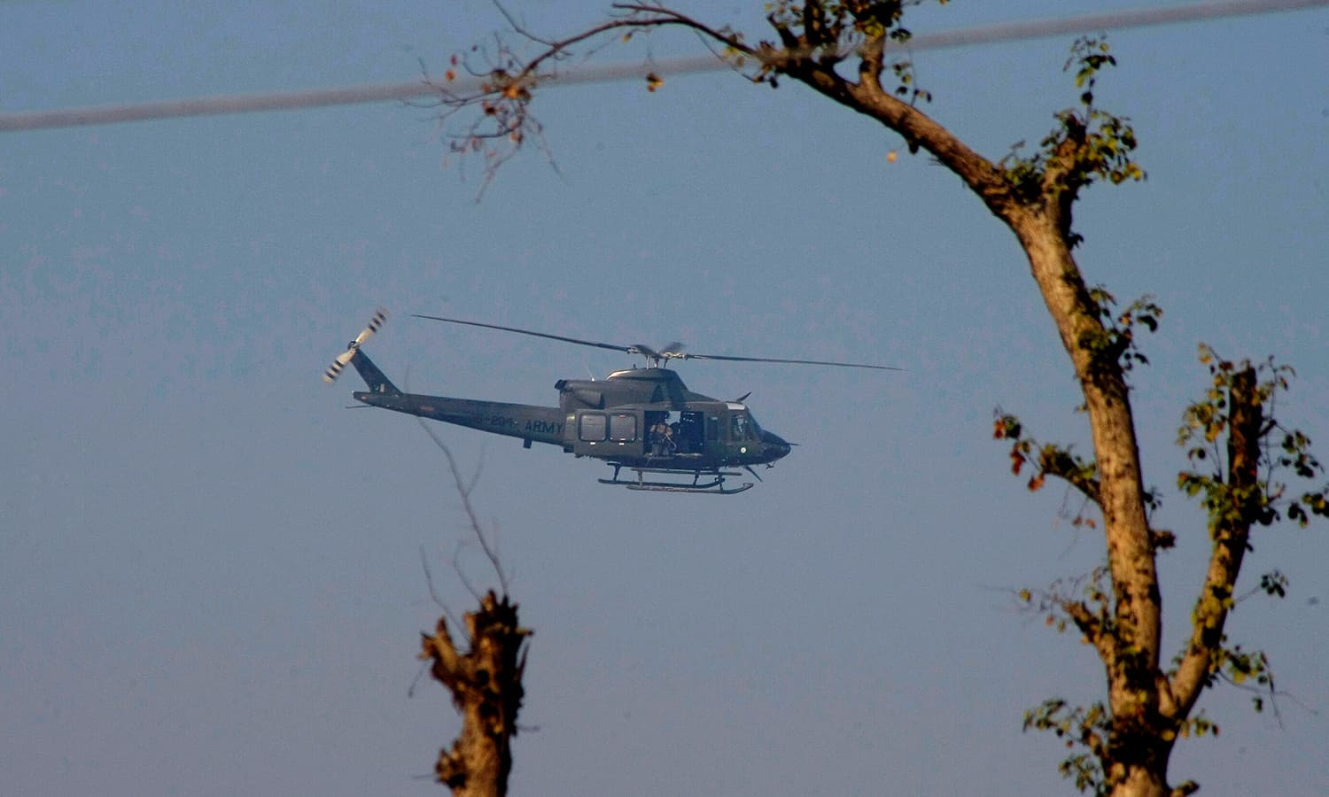A Pakistan army helicopter flies over the Bacha Khan University as the troops on the ground cleared the area. — AP