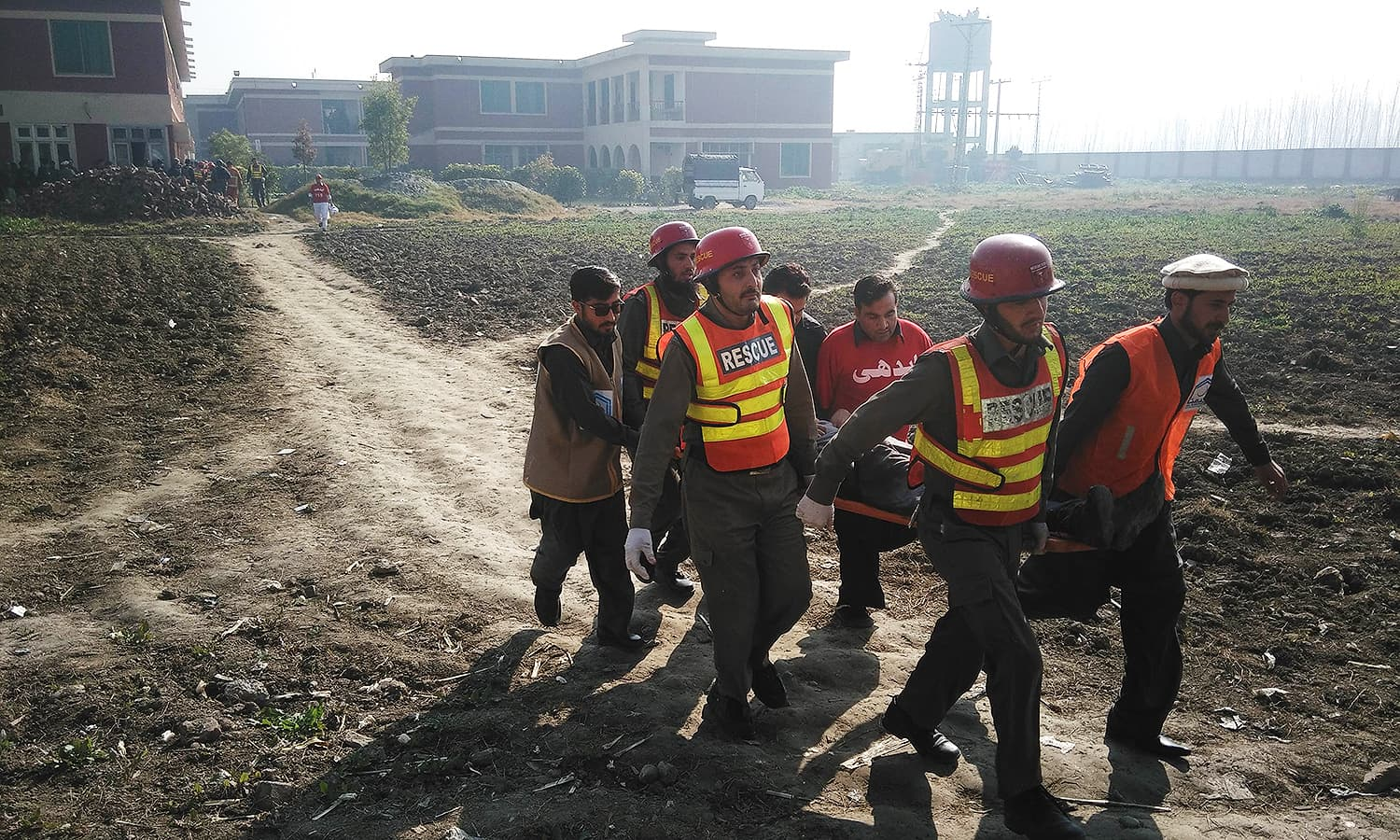 Rescuers shift an injured person outside the university. — AFP