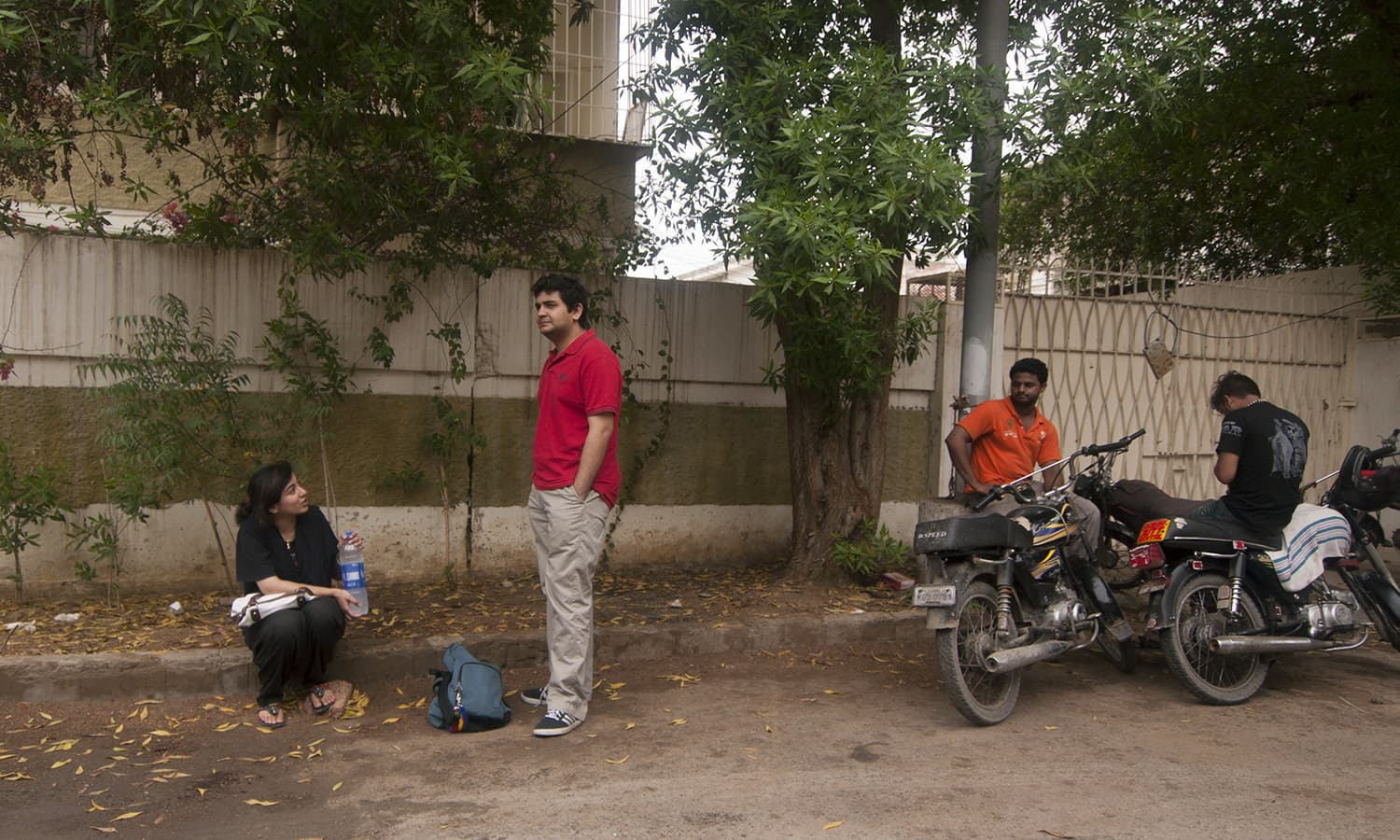 A man staring unabashedly at one of my friends hanging out on a roadside near Mohammad Ali Society. —Photo courtesy Girls at Dhabas