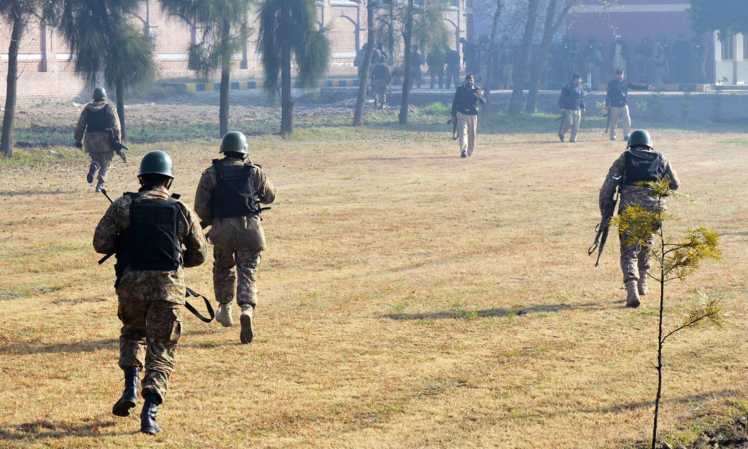 Pakistani army soldiers take part in search operation at the Bacha Khan university following an attack by militants in Charsadda. -AFP