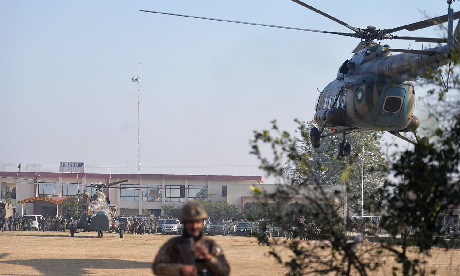 An army helicopter (R) carrying Chief of Army Staff General Raheel Sharif arrives at Bacha Khan university. -AFP