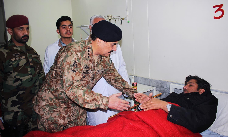 Chief of Army Staff General Raheel Sharif talks to a man injured in an attack Bacha Khan university, at a local hospital in Charsadda. -AP