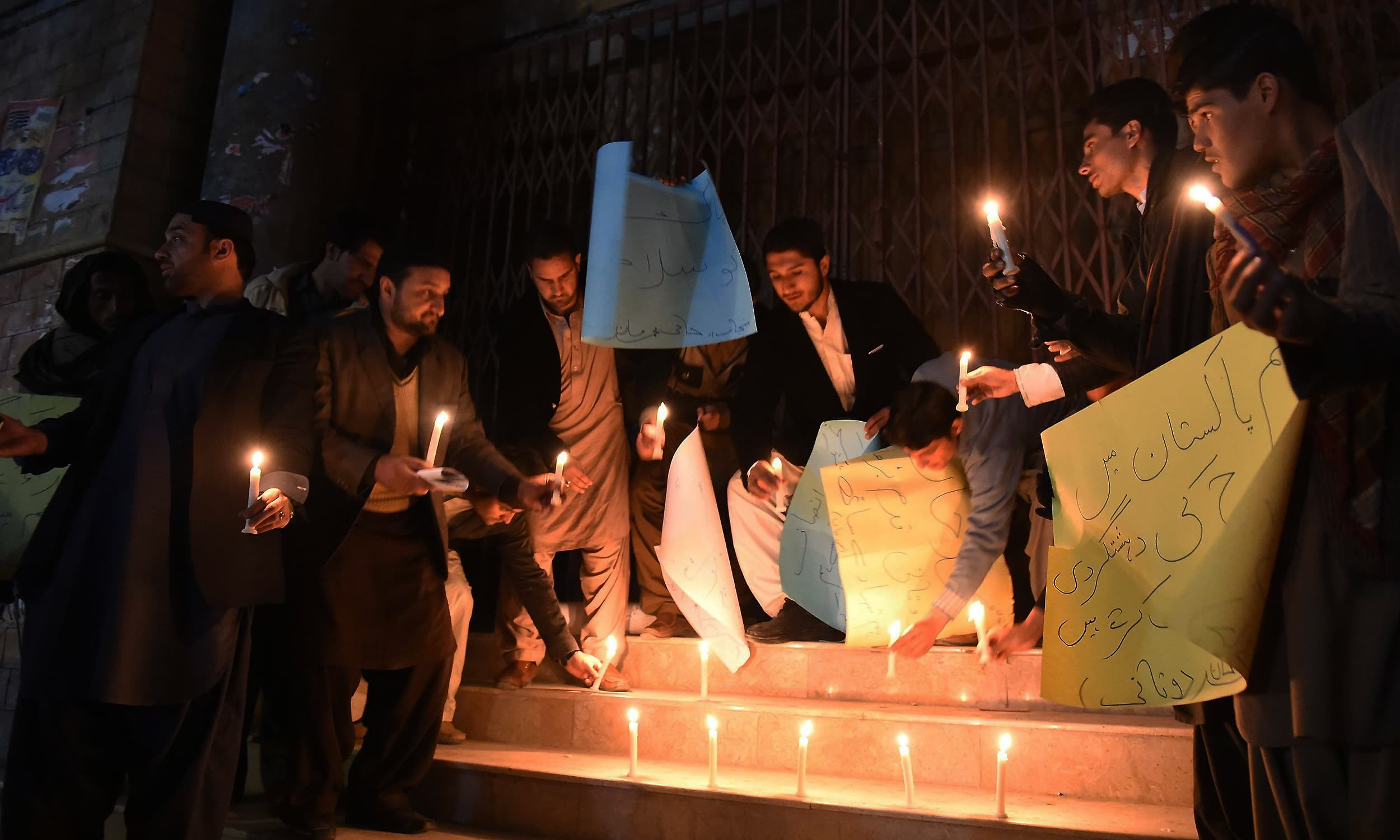 Students in Quetta lights candles for victims of the Bacha Khan University attack. ─ AFP