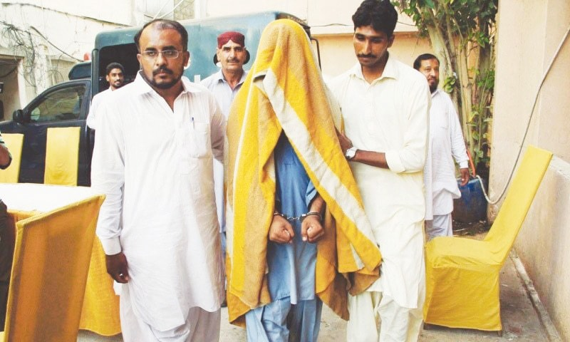 A Hizbut Tahrir suspect being brought to the CTD office in Karachi | Courtesy dawn.com