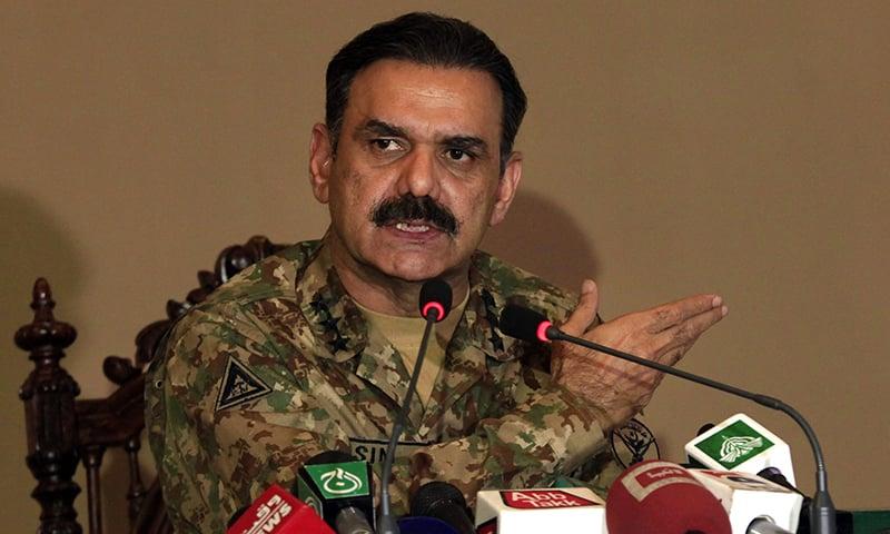 Lt-Gen Asim Bajwa addresses a news conference in Peshawar. —AP