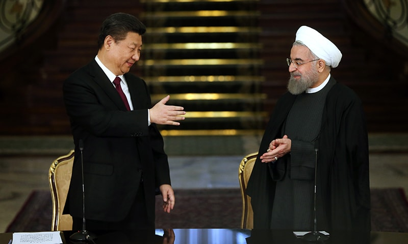 Chinese President Xi Jinping and his Iranian counterpart Hassan Rouhani prepare to shake hands at the conclusion of their joint press conference at the Saadabad Palace in Tehran. AP