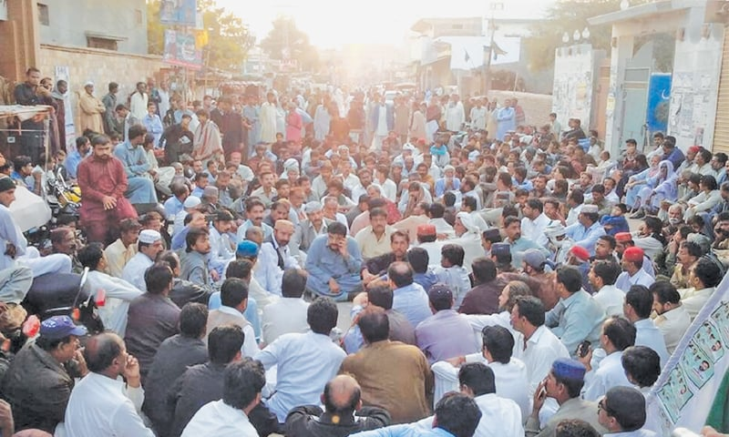 Supporters of Dr Mirza group hold a sit-in outside the Badin Press Club on Sunday.—Dawn