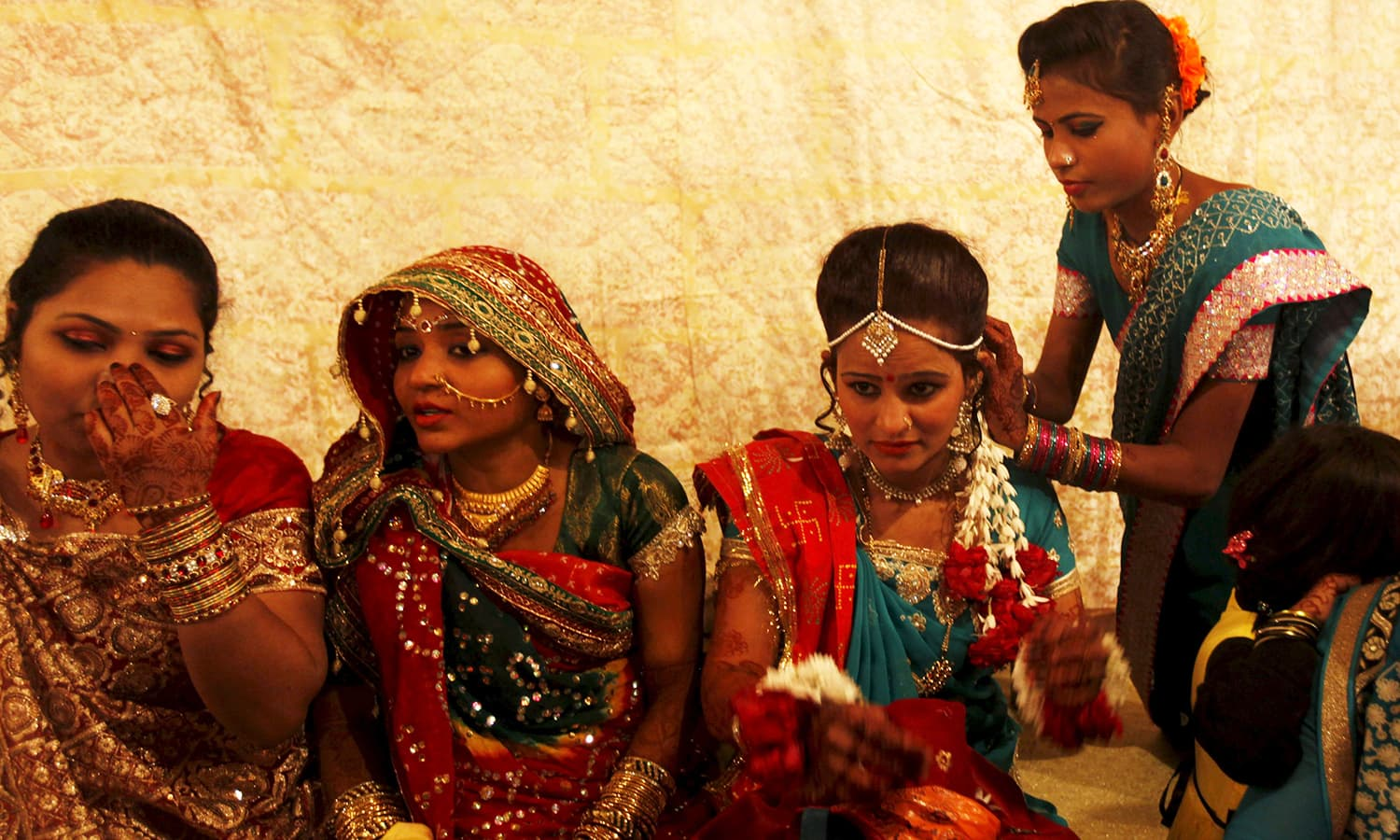 A bride and her party prepare as they wait for their wedding to start. ─ Reuters