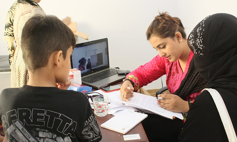 Patients in session with a doctor at doctHERs' clinic in Model Colony, Karachi. —Photo courtesy doctHERs