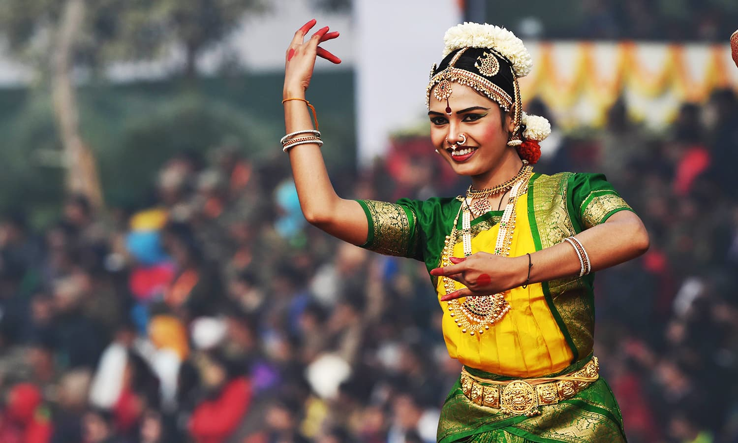 An Indian dancer performs on a float during India's Republic Day parade. ─ AFP