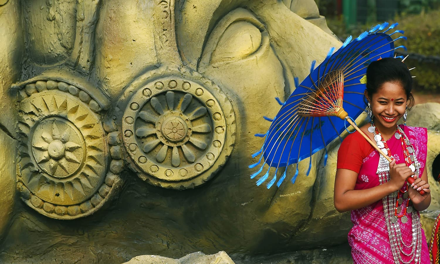 An Indian woman stands on a float promoting ancient sculptures in the eastern India state of Tripura. ─ AFP