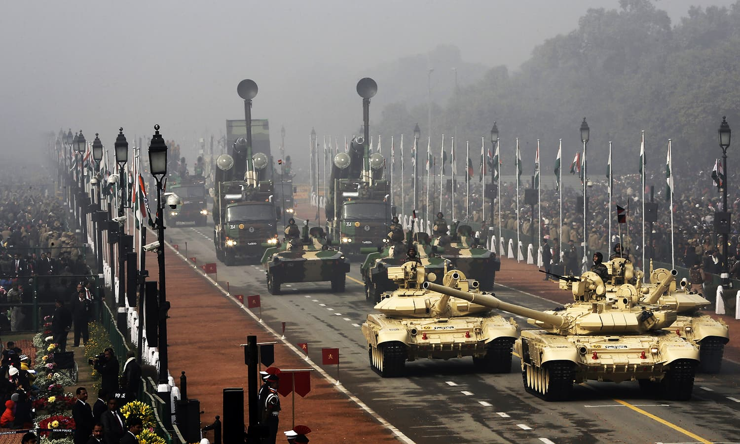 Indian Army's T-90 Bhishma tanks (front) are displayed during the Republic Day parade. ─ Reuters