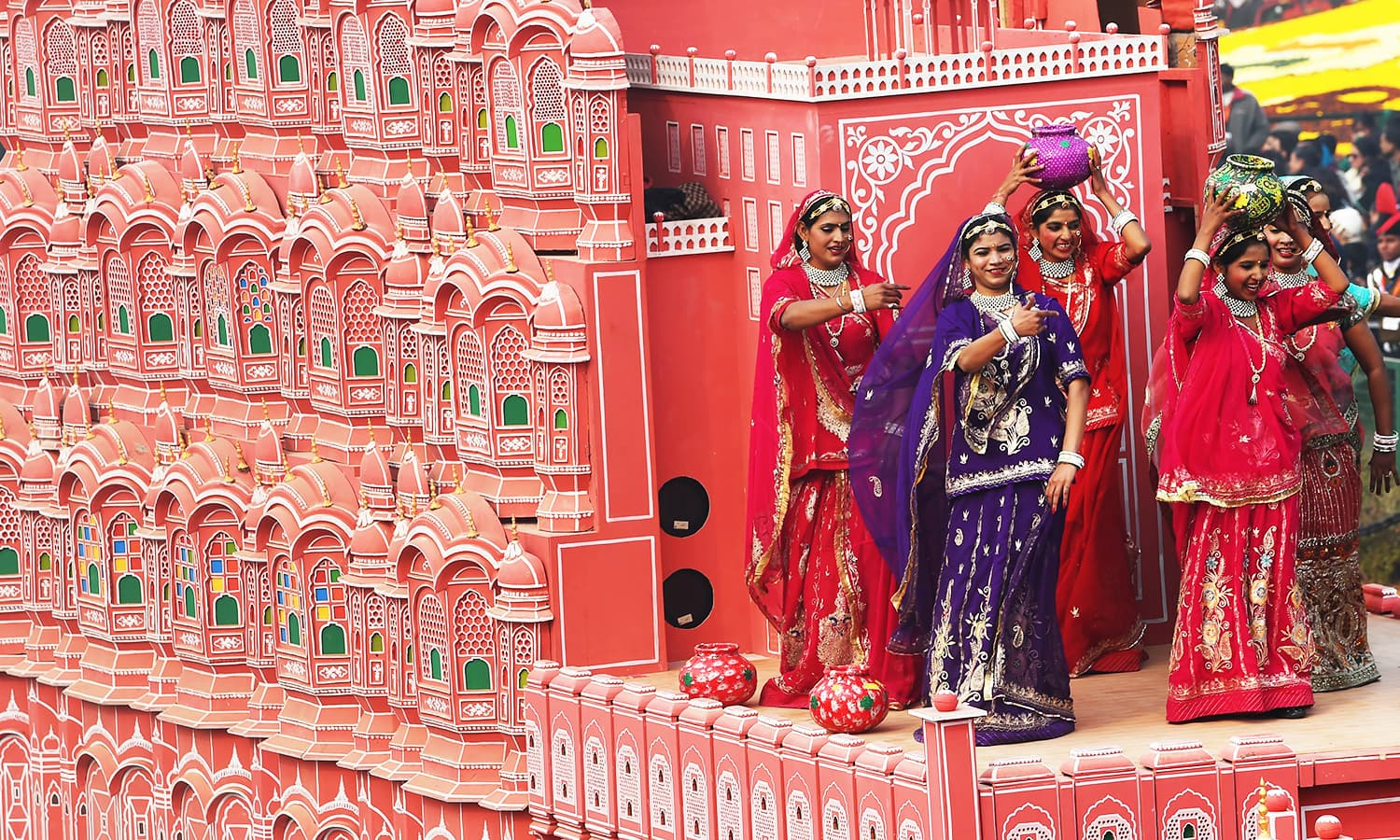 Women wearing traditional clothes from the state of Rajasthan ride a float during India's Republic Day parade. ─ AFP
