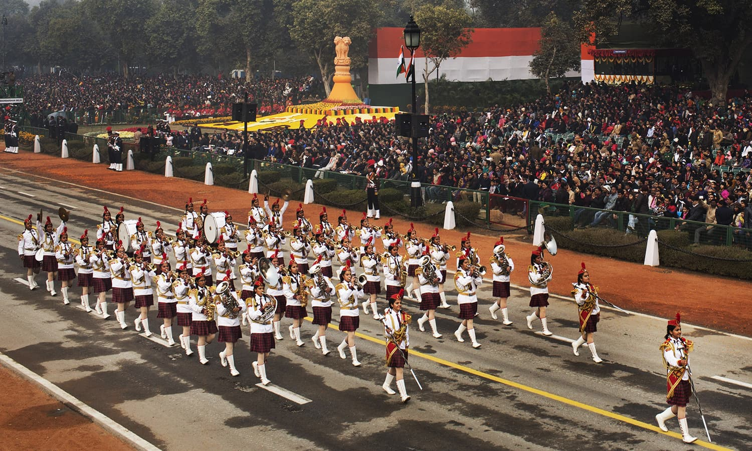Women members of India's National Cadet Corps (NCC) march during the Republic Day parade. ─ AP