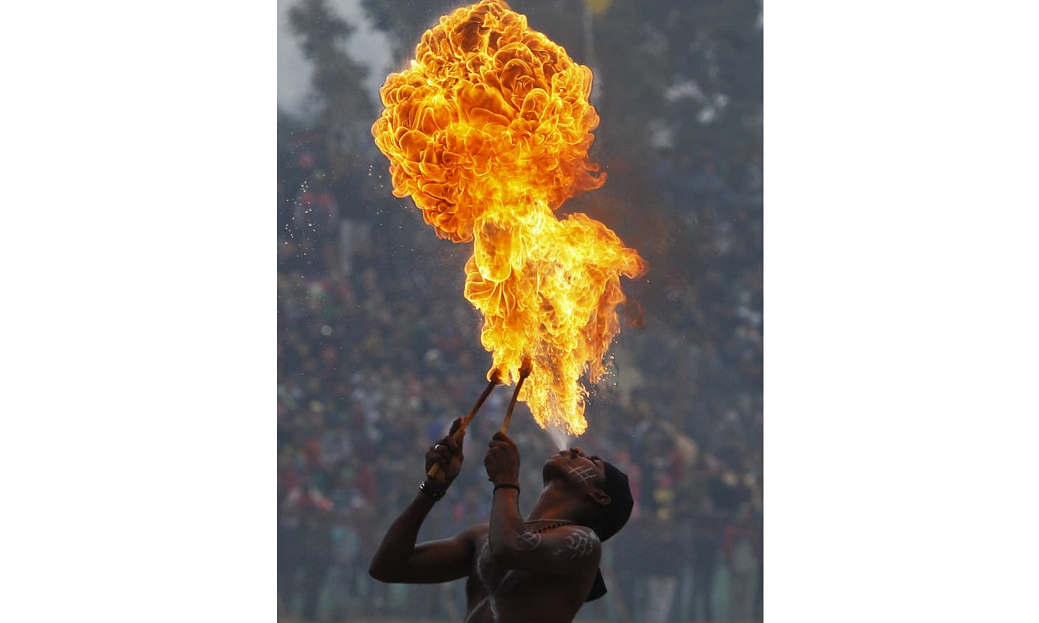 An Indian artist performs a fire act during Republic Day celebrations. ─ AP