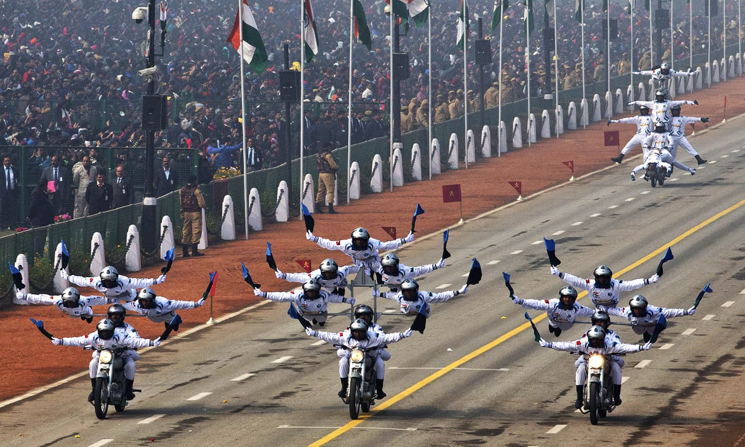 Motorcycle display team of Indian army's 'Corps of Signals',  popularly known as 'Dare Devils', make formations on motorcycles as they roll down Rajpath during the parade. ─ AP