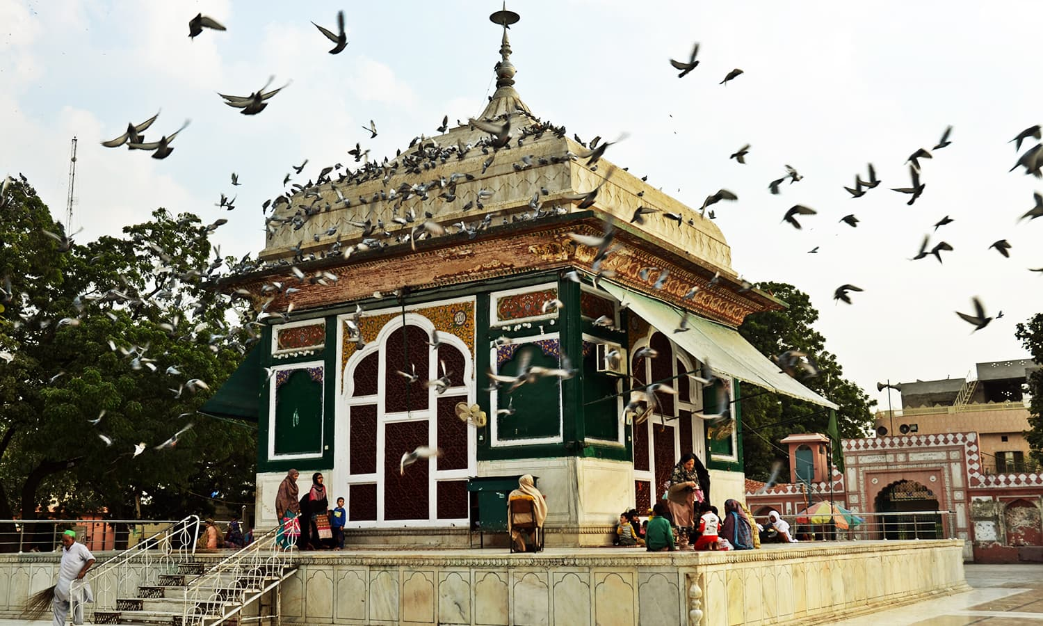 Pigeons are attracted to the serenity of shrine. —Photo by Abdullah Khan