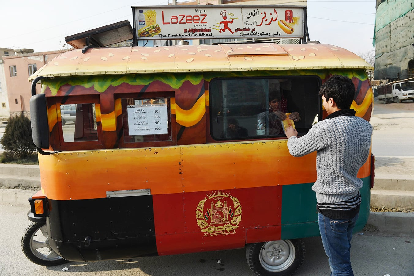 An Afghan Customer Buys A Burger From Lazeez Food Truck In Kabul Photo Taken