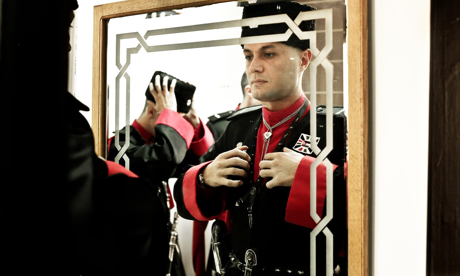 36 year-old Circassian Warrant Officer Zaid Hosni Younis adjusts his 'Hazar' or cylinders on both sides of the chest which were used to hold gunpowder, inside the Circassian Headquarters in Basman Palace. ─ AP