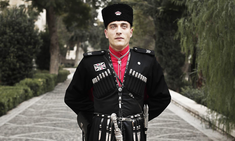 28 year-old Circassian guard Sergeant Tariq Fuad Beshto, poses for a photograph outside Basman Palace in Amman, Jordan. ─ AP