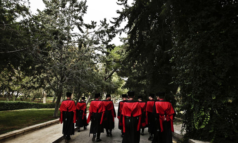 Circassian guards march near Raghadan Palace, in Amman, Jordan. ─ AP